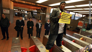 A man protests the case of California transit police officer Johannes Mehserle, convicted of killing Oscar Grant.