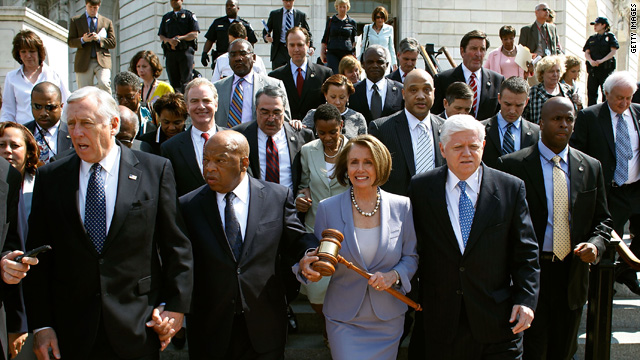 Speaker of the House Rep. Nancy Pelosi, D-California, carries the gavel that was used when Medicare was passed while walking with other congressional Democrats to the Capitol before the health care vote Sunday.