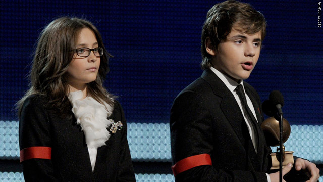 Paris, left, and Prince Michael Jackson accept the Lifetime Achievement award for their late father, Michael Jackson.