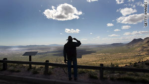 A rancher scans the Mexican border from Arizona, which critics say has less protection than Texas and California.