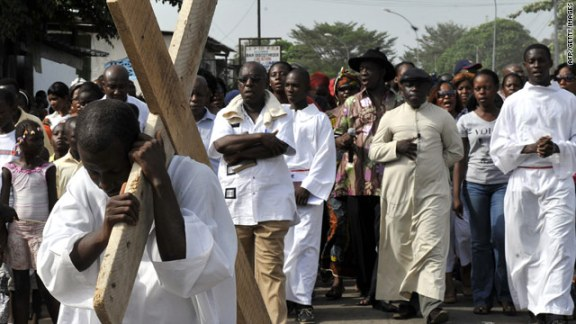A man performs the Stations of the Cross during the Good Friday procession earlier this month in Abidjan, Ivory Coast.