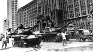 This photo from 1964 shows a scene from a military takeover Brazil. Tanks and soldiers move into Rio de Janeiro.