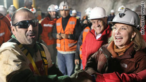 Mario Sepulveda greets Chilean first lady Cecilia Morel after his return to the surface.