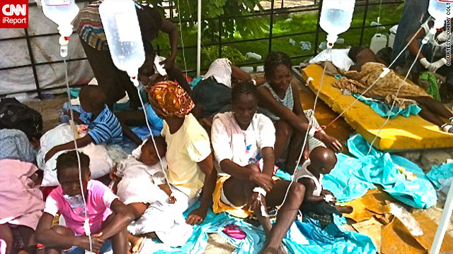 Cholera patients receive hydration drips Friday at a clinic in St. Marc, Haiti.