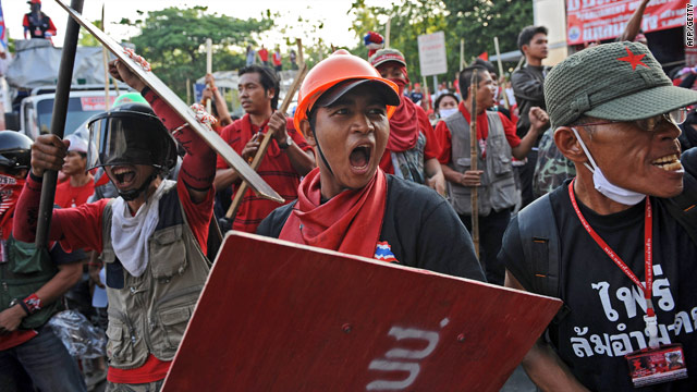"""Red Shirt"" anti-government protesters take to the streets Friday in Bangkok."