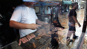 A cook grills meat balls in a restaurant at Skopje's old bazaar.