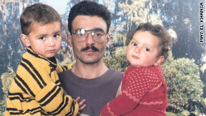Ali Hussain Sibat pictured with two of his five children.