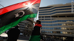 Libyan demonstrators in Washington on Tuesday display the pre-Gadhafi Libyan flag.