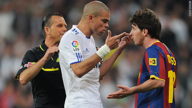 Real Madrid's Pepe, left, gestures at Barcelona goalscorer Lionel Messi during Saturday's tense Clasico clash at the Bernabeu.