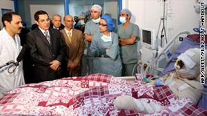 Former Tunisian President Zine El-Abidine Ben Ali (second left) visits Mohamed Al Bouazzizi (right) at the hospital in Ben Arous near Tunis on December 28, 2010. Source: Handout from Tunisian Presidency of Zine El-Abidine Ben Ali.
