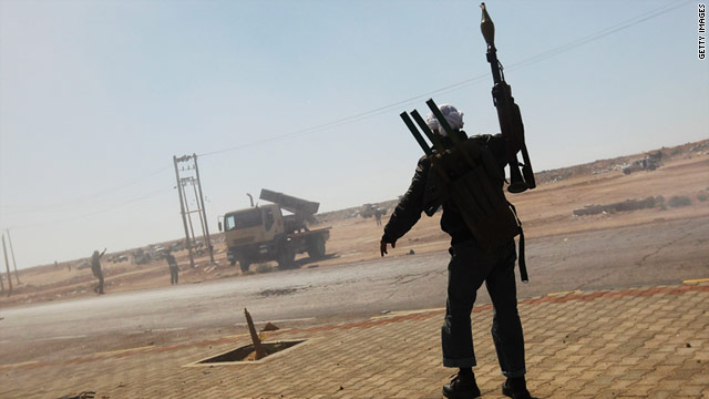 A rebel fighter celebrates in April after firing a rocket. A U.S. general says he's worried about shoulder-fired missiles in Libya.