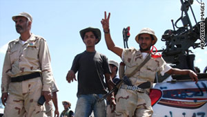 Fighters gather near Bani Walid on Saturday as the deadline expires for forces loyal Moammer Ghadafi to surrender.