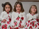 Three's company: Big sister Cara, centre, is only nine months older than her sisters, twins Laura, left and Jenna
