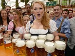 Oktoberfest begins: Waitress Beli carries the first bevy of beer jugs