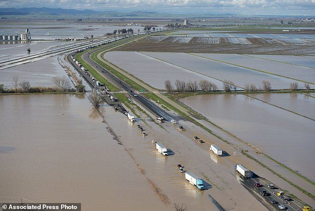 In this view looking north, flood water crosses over Interstate 5 at Williams backing up traffic in both north and southbound lanes for hours on Saturday