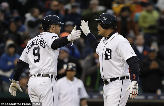 Detroit Tigers' Miguel Cabrera, right, is congratulated by Nicholas Castellanos (9) after they both scored on Cabrera's two-run home run during the third inning of a baseball game against the Cleveland Indians, Tuesday, May 2, 2017, in Detroit. (AP Photo/Carlos Osorio)