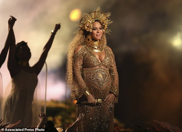 FILE - In this Feb. 12, 2017, file photo, Beyonce performs at the 59th annual Grammy Awards in Los Angeles. The pop star is nominated for seven awards at the 2017 BET Awards, the network told The Associated Press on Monday, May 15. The show will take place June 25 at the Microsoft Theater in Los Angeles. (Photo by Matt Sayles/Invision/AP, File)