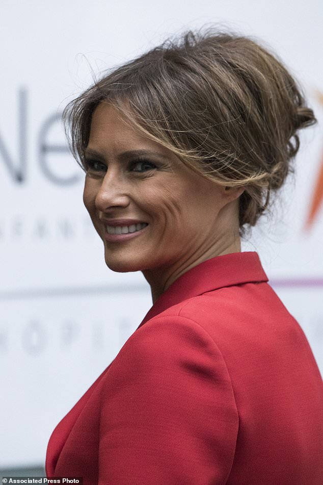 First Lady Melania Trump smiles as she visits the Necker hospital, France's biggest pediatric hospital in Paris, Thursday July 13, 2017. Melania Trump is touring the hospital shortly after her arrival in France with President Donald Trump aboard Air Force One. (AP Photo/Kamil Zihnioglu)