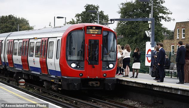Commuters are seen on the platform at Parsons Green station in London, Monday, Sept. 18, 2017. A bucket wrapped in an insulated bag caught fire on a packed London subway train at Parsons Green station on Friday Sept. 15, police are treating it as a terrorist incident. (AP Photo/Kirsty Wigglesworth)