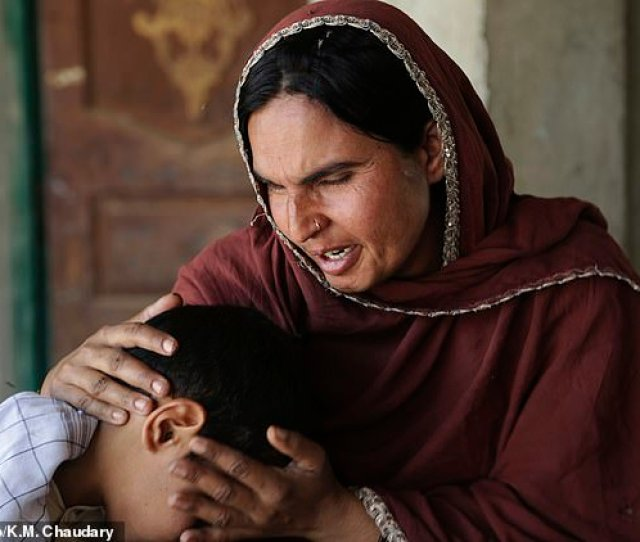 Kausar Parveen Comforts Her Child Who Was Allegedly Raped By A Mullah Or Religious Cleric