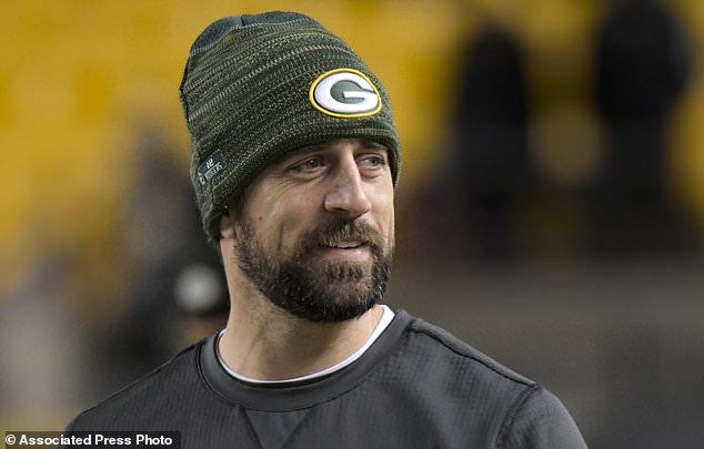 In this Nov. 26, 2017, photo, Green Bay Packers quarterback Aaron Rodgers watches warmups before an NFL football game against the Pittsburgh Steelers in Pittsburgh. Rodgers has been
