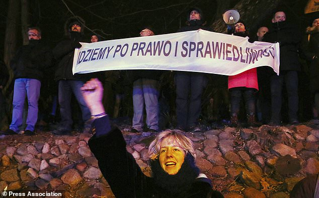 Protesters demonstrate against government policies in Warsaw (Czarek Sokolowski/AP)
