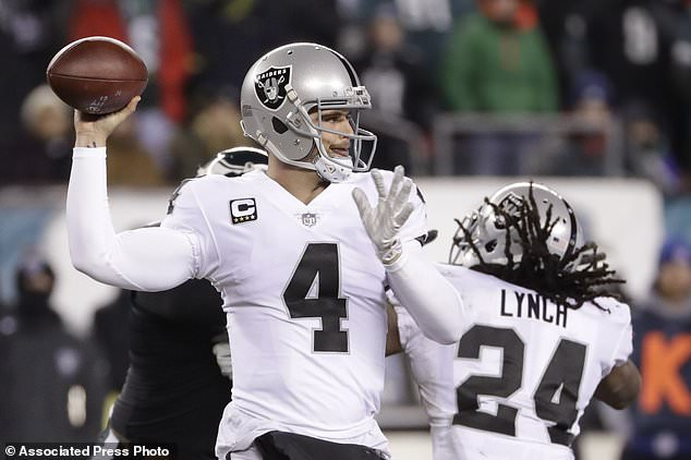 Oakland Raiders' Derek Carr passes during the first half of an NFL football game against the Philadelphia Eagles, Monday, Dec. 25, 2017, in Philadelphia. (AP Photo/Michael Perez)