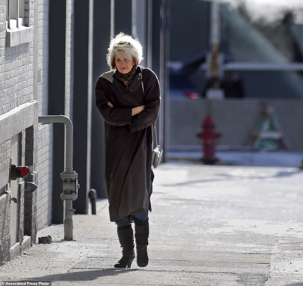 Maryann Sander, a teacher in southeast Wisconsin, gets out of the cold at Stone Creek Coffee as single digit bitter cold temperatures spread across southeast Wisconsin Tuesday