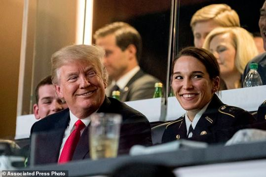 President Donald Trump smiles while watching the NCAA National Championship game at Mercedes-Benz Stadium, Monday, Jan. 8, 2018, in Atlanta, between Alabama and Georgia. (AP Photo/Andrew Harnik)