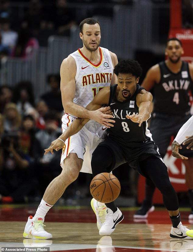 Brooklyn Nets guard Spencer Dinwiddie (8) and Atlanta Hawks center Miles Plumlee (18) battle for the ball in the first half of an NBA basketball game Friday, Jan. 12, 2018, in Atlanta. (AP Photo/John Bazemore)