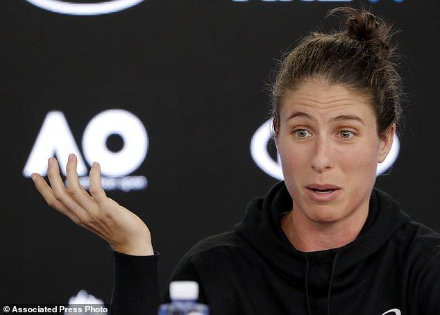 Britain's Johanna Konta gestures during a press conference at the Australian Open tennis championships in Melbourne, Australia, Saturday, Jan. 13, 2018. (AP Photo/Dita Alangkara)