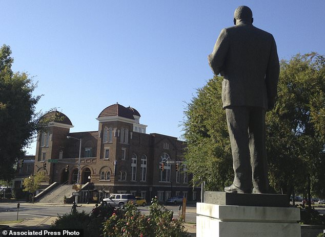 FILE - In this Oct. 15, 2015, file photo, a statue of Rev. Martin Luther King, Jr. overlooks the 16th Street Baptist Church in Birmingham, Ala., where advocates say officials are doing a good job at preserving sites links to civil rights. The site is among about 130 locations in 14 states being promoted as part of the new U.S. Civil Rights Trail, which organizers hope will boost tourism in the region. (AP Photo/Russell Contreras, File)