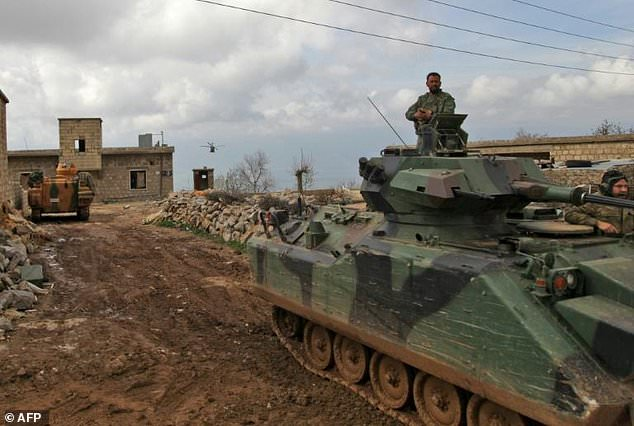 Turkish forces and army helicopters advance towards the village of Al-Maabatli in the Afrin region in the northwestern Aleppo province countryside on March 2, 2018
