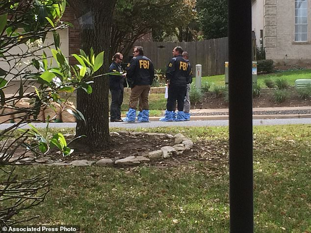 Authorities work the scene in Austin, Texas, Monday, March 19, 2018 on Eagle Feather Drive, near where the bomb exploded. The photo was taken three houses from the intersection of Dawn Song and Eagle Feather, where the bomb exploded. Two people have now been killed and four wounded in bombings over a span of less than three weeks. (Kimberly K. Smith via AP)