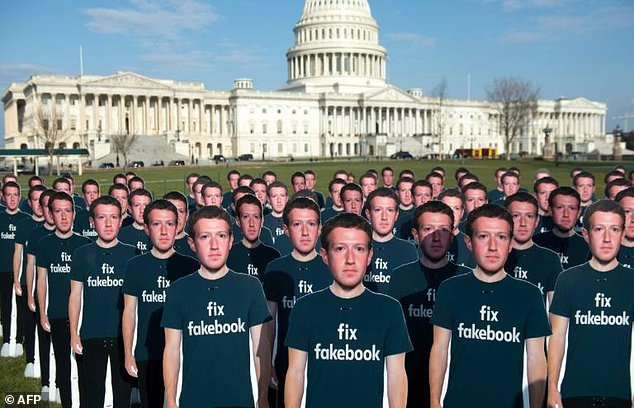 Cardboard cutouts of Facebook CEO Mark Zuckerberg stand outside the US Capitol, placed by advocacy group Avaaz to call attention to what the group says are fake accounts still spreading disinformation on Facebook