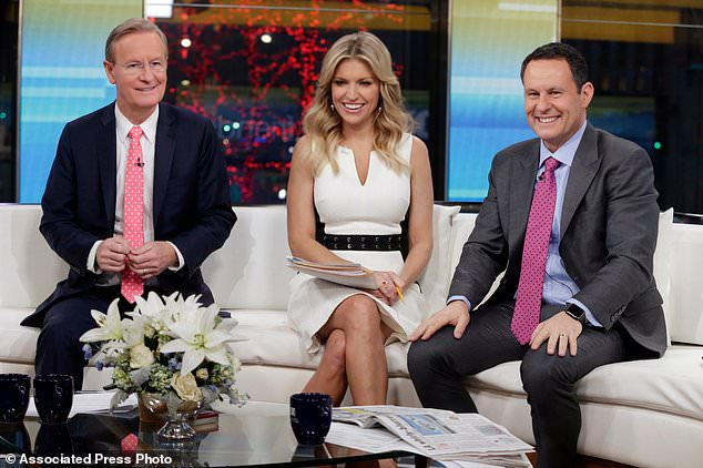 Earhardt joined Fox & Friends as co-host in 2016, pictured with fellow cohosts Steve Doocy (left) Ainsley Earhardt and Brian Kilmeade (right) in New York in January