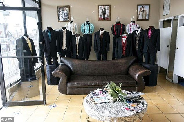 A view inside Martinez Tuxedos, where Thomas Markle tried to stage photographs before settling for images of an assistant at a party supply shop measuring him for a suit