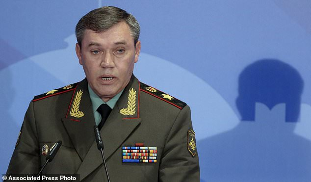 FILE - In this Thursday, May 23, 2013 file photo Gen. Valery Gerasimov, the chief of the Russian military's General Staff, speaks during a security conference in Moscow, Russia. The Finnish Defense Forces said Gen. Joseph Dunford, current chairman of the Joint Chiefs of Staff, and Russia's chief of the military's General Staff, Gen. Valery Gerasimov, will meet in Helsinki to discuss