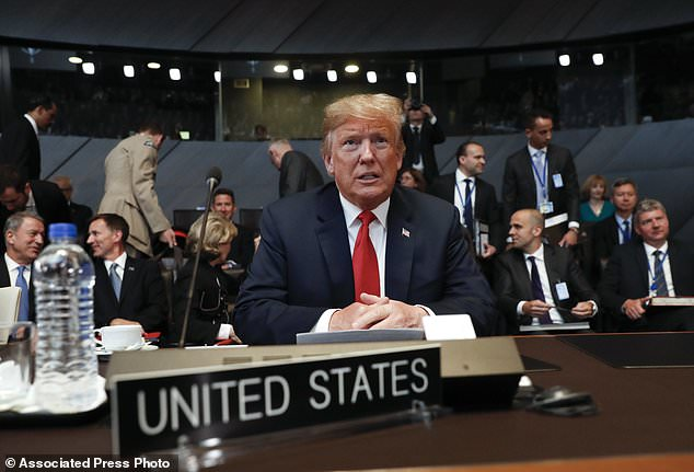 U.S. President Donald Trump takes his seat as he attends the multilateral meeting of the North Atlantic Council, Wednesday, July 11, 2018 in Brussels, Belgium. (AP Photo/Pablo Martinez Monsivais/pool)