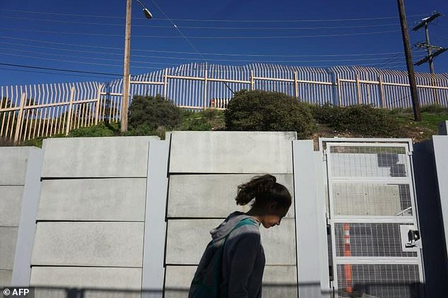 Part of the existing border wall in San Ysidro, California is pictured here; Trump has vowed to make Mexico pay for a wall along the entire length of the frontier