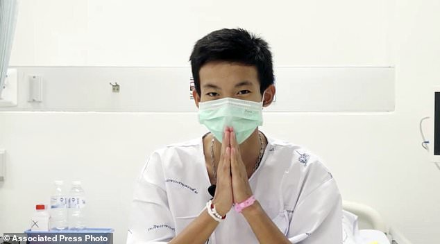 This picture, taken on July 13, 2018 and published by Chiang Rai Prachanukroh Hospital, shows Peerapat Sompiangjai, one of 12 boys rescued from the flooded cave, in her hospital room at the Chiang Rai Prachanukroh Hospital in Chiang Rai Province, Thailand , The video was shown during a press conference on Saturday, July 14, 2018 in the hospital. (Chiang Rai Prachanukroh Hospital via AP)
