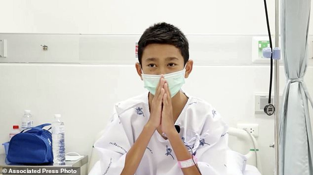 This image from a video taken on July 13, 2018 and published by Chiang Rai Prachanukroh Hospital shows Nattavut Takhamsai, one of 12 boys rescued from the flooded cave, in her hospital room at Chiang Rai Prachanukroh Hospital in the province Chiang Rai Thailand. The video was shown during a press conference on Saturday, July 14, 2018 in the hospital. (Chiang Rai Prachanukroh Hospital via AP)