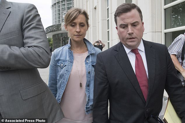 Raniere and Allison Mack (above leaving court last month) are accused of coercing Nxivm followers into becoming slaves to senior members