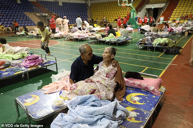 A couple is seen at a temporary shelter in Yangchun.Three million people were evacuated