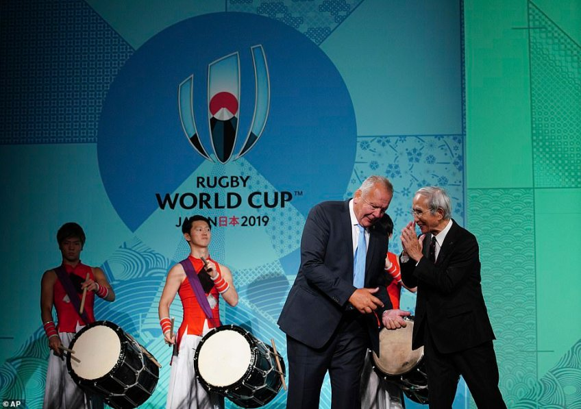 Bill Beaumont, chairman of World Rugby and Japan rugby chief Tadashi Okamurachat during the ceremony
