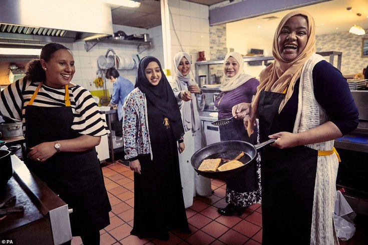 (From left) Hiwot Dagnachew, Aysha Bora, Halima Al-huthaifi, Ahlam Saeid and Munira Mahmud cooking in the kitchen
