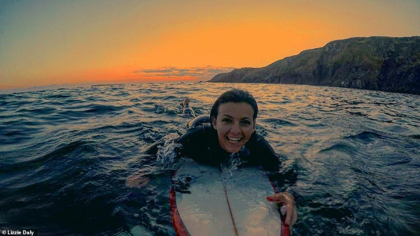 Surfer chick: The wildlife presenter (above) donned a wetsuit and headed out into the open waters at West Dale beach to catch some waves
