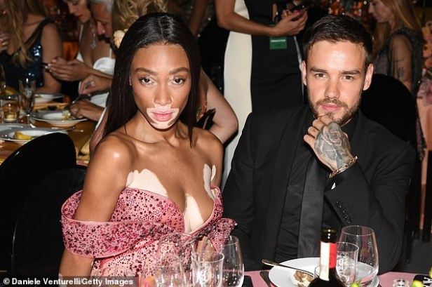 Good company: Winnie was seen cosying up to newly-single Liam Payne when they were sat indulging on the sumptuous banquet