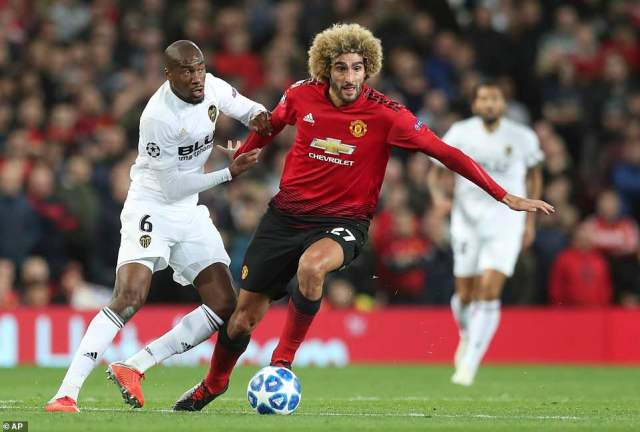 Kondogbia fights for the ball in the middle of the park with United's giant midfield player Marouane Fellaini