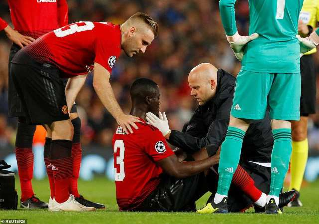 Defender Eric Bailly receives treatment from United's medical staff after suffering a minor injury in the first period